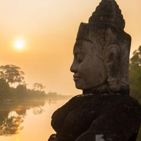 Buddha is shown over a body of water in Angkor Wat, where Projects Abroad volunteers visit and educate themselves on Khmer history.